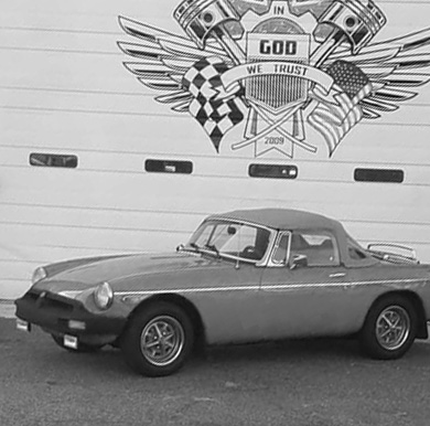 classic car parked in front of GeorgiaLina Automotive service bay